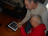 Ray helps Lyn with iPad