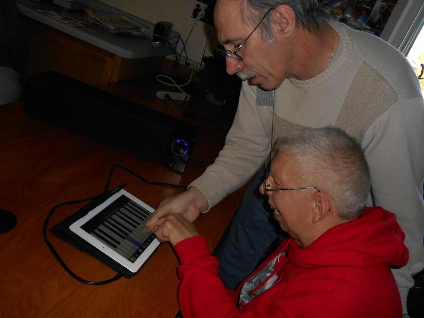 Ray helps Lyn with iPad