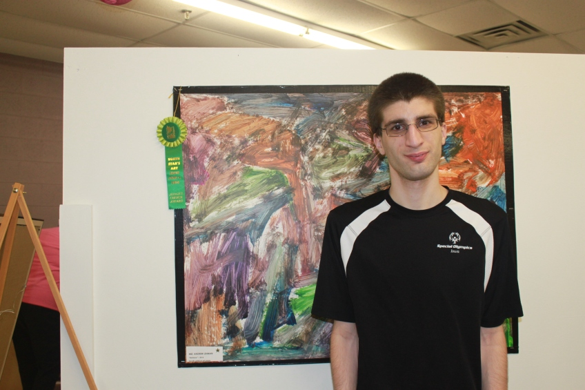 Andy is proud of his Judge's Choice award at the art show.