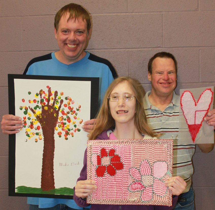 Mike Crissy and Doug show off their artistic creations.